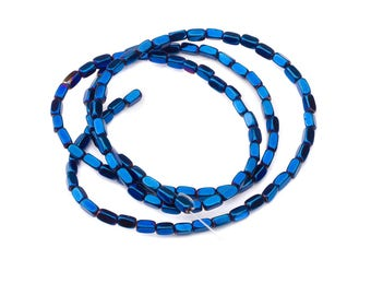 10 hematite nugget beads, metallic blue, 4 x 2 mm