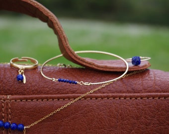 Bangle is gilded in gold, Lapis Lazuli stones