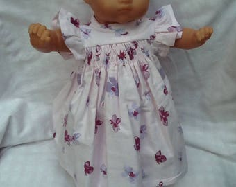 Dress has pink butterflies smocked ref4, purple dolls clothes
