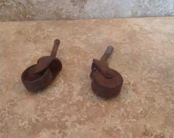 2 mismatched vintage casters