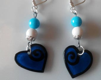 Earrings with shrink plastic and beads.