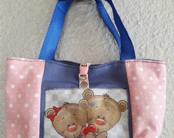 Pink girl bag and teddy bear