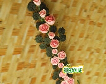Miniature dolls house string of pink roses