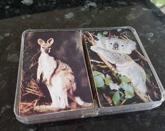 Australian used double deck of cards featuring koala and kangarooin plastic container