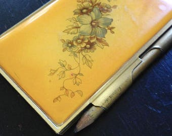 Golden notepad case and pencil
