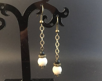 Pearl beige fossil and matte black stone, chain and bronze rondelle earrings