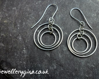 Sterling silver triple ring earrings. Silver earrings made with three matching rings.