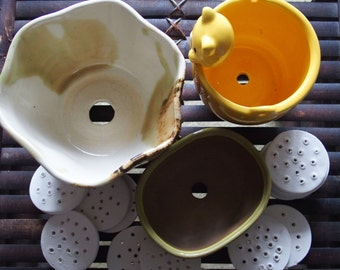 Pot spots - handmade pottery drainage hole covers for plant pots