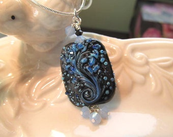 Necklace blue and black glass lampwork bead decorated with blue and black crystals