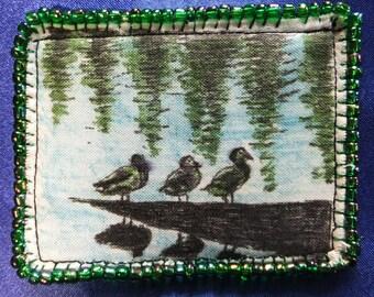 Tiny Art Quilt ATC Three Ducks Resting on a Log