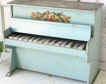 A beautiful vintage French child's wooden blue toy piano