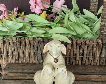 hand sculpted polymer resting ewe and 2 lambs