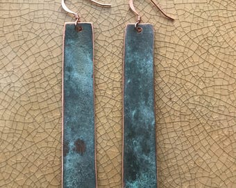 Copper esrrings with natural patina.
