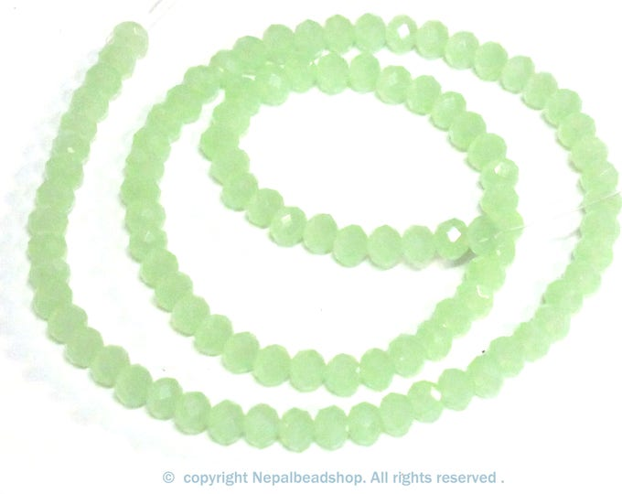 1 strand 13 inches long - 4 mm size Faceted rondelle shape pastel green color crystal glass beads - AB052B