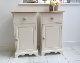 Up- cycled, shabby chic style winter white bedside cupboards.