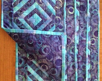 Four (4) handmade quilted placemats