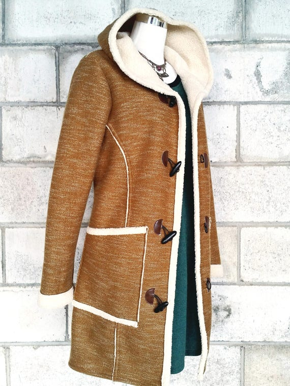 The Billie coat, jacket in brown with wool-look lining.