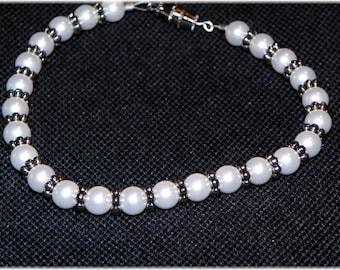 Swarovski pearl and Silver flower bead bracelet