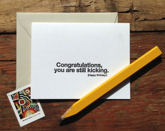 SASS-437 Birthday letterpress card - Congratulations you're still kicking