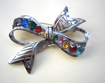Vintage bow rhinestone brooch, 1980s
