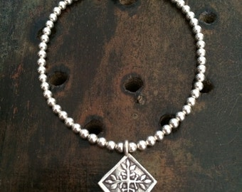 Silver Beaded Bracelet with a Hill Tribe Silver Charm