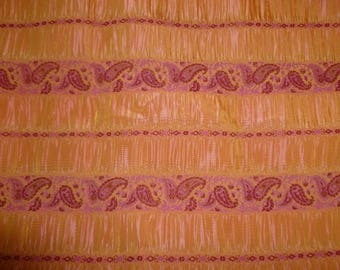 Orange fuschia smok fabric