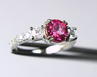 Beautiful Genuine Peony Topaz in a Glowing Accented Sterling Silver Setting