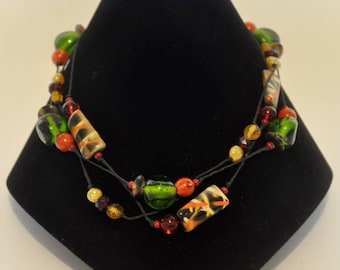 Glass and ceramic bead multi-strand necklace