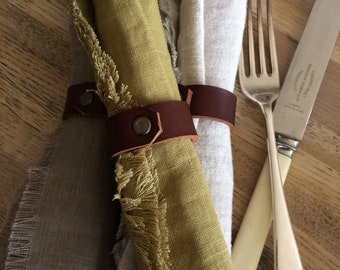 Set of 6 linen napkins in olive, natural and taupe.