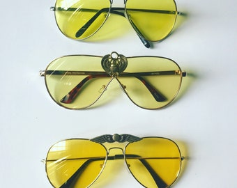 Flyyy- yellow aviator sunglasses with Kemetic God wings