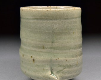 Unique Handmade Stoneware Yunomi glazed with Celadon, fired in reduction with a trace of Carbon Trapping