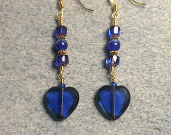 Dark blue Czech glass heart bead dangle earrings adorned with dark blue Czech glass beads.