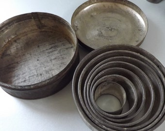 Old pastry cutters in original tin ideal for primitive kitchen display or use