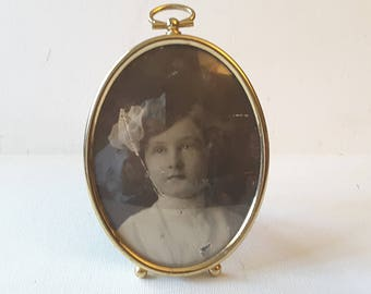 Oval brass frame, with glass