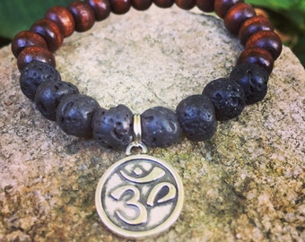 Earth and Fire yogi inspired wood bead meditation mala buddha bracelet in wood and lava with om symbol for men or women