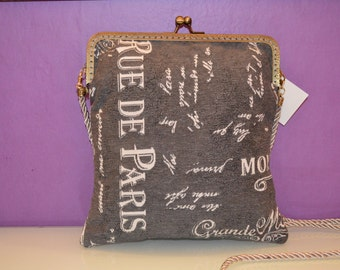 bag stamped with kiss clasp