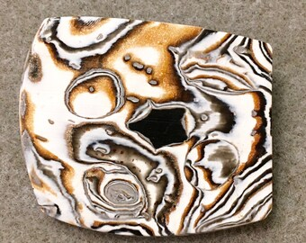 Dramatic polymer clay pin in an organic black, white and copper design