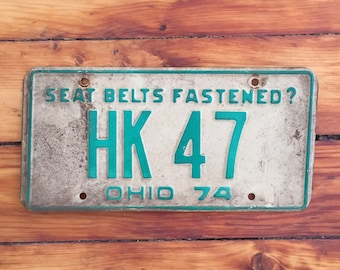 """One Ohio License Plate from 1974  """"Seat Belts Fastened?"""""""