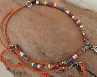 Necklace with suede and ceramic and metal parts