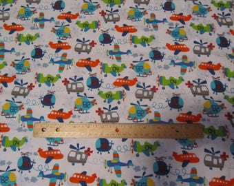 White with Multicolored Airplanes and Helicopters Flannel Fabric by the Yard