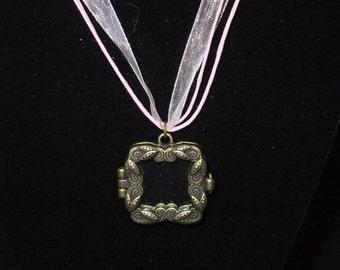 Gold Frame Locket on Pink Ribbon