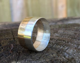 Gold band with silver inlay