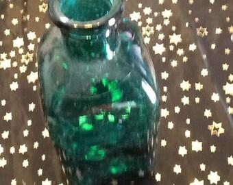 Green vintage square shaped bottle