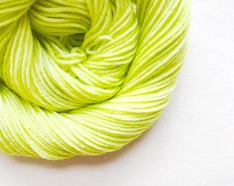 LIMELIGHT hand dyed yarn fingering sock dk bulky yarn super wash merino wool yarn single or ply. choose your base. light lime green yarn