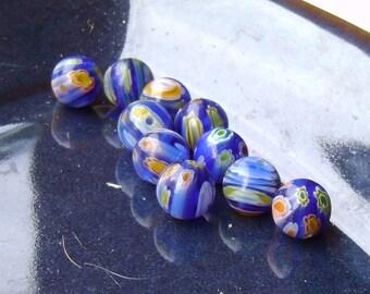 Six Blue Marble Like Glass Beads