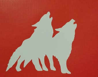 Two wolves howling decal sticker