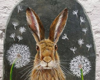 Wild hare with dandelion clock