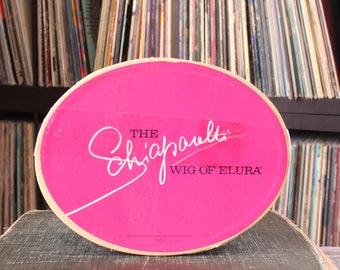 vintage Schiaparelli wig box, wig of Elura shocking pink & black