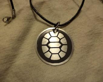 TMNT inspired 2 sided nickel silver pendant