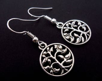A pair of pretty tree of life dangly earrings.